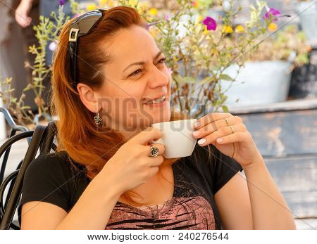 Pretty Lady Drinking Coffee On Caffe Terrace