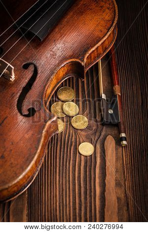 Violin Waist Detail With Bow On Rustic Wooden Background