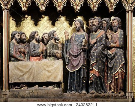 PARIS, FRANCE - JANUARY 04, 2018: Intricately carved and painted frieze inside Notre Dame Cathedral depicting Appearance to the Apostles in Ascension Day, UNESCO World Heritage Site in Paris, France.