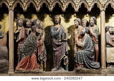 PARIS, FRANCE - JANUARY 04, 2018: Intricately carved and painted frieze inside Notre Dame Cathedral depicting Appearance to the apostles and disciples in Galilee, UNESCO World Heritage Site in Paris.