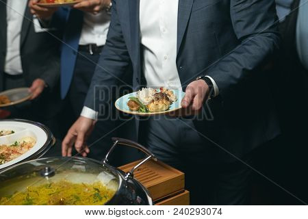Catering Buffet Food Indoor In Luxury Restaurant With Meat Colorful Fruits And Vegetables. People At