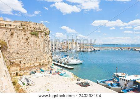Gallipoli, Apulia, Italy - Sailing Boats At The Harbor Near The Historical City Wall