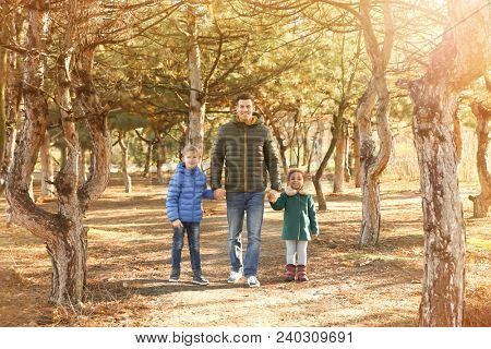 Father and little kids outdoors on sunny day. Child adoption