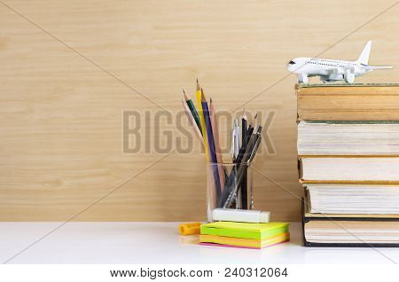 Hardback Or Textbook Stacked And Stationary Placed On The Table. The Concept Of Intelligence Comes F