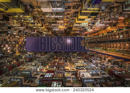Overcrowded residential building in Hong Kong, China poster