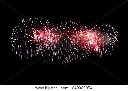 Colorful Explosions Of Festive Fireworks In The Night Sky