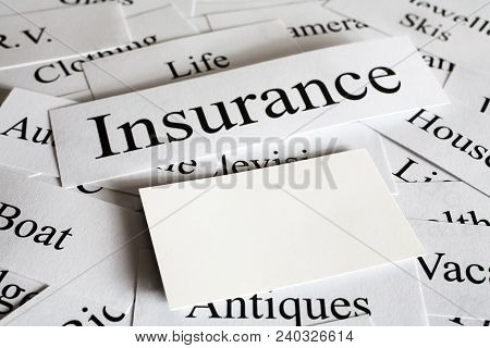 A Conceptual Look At Insurance And The Things You Need Cover For, With Space For Your Business Card.