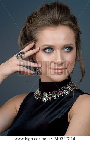 Woman With Jewelry Set. Girl With Fashionable Jewelry Earrings And Ring