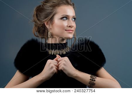 Beautiful Woman In A Necklace, Earrings And Big Ring. Beauty And Accessories.