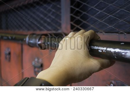 Hand On Red Metal Antique Distressed Cabinet, Stock Photo