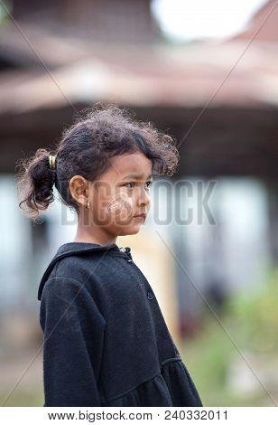 Sankar, Myanmar - January 17, 2011: Burmese Girl With Thanaka Paste On Her Face Poses For A Photo Du
