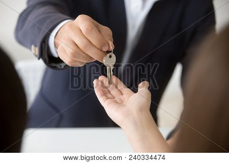 Realtor Giving Woman Keys To New Apartment, Agent Making Deal With Client Buyer Owner Tenant Renter