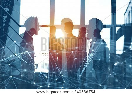 Business People Work Together In Office With Skyscraper On Background With Internet Network Effects.