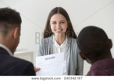 Happy Smiling Millennial Applicant Being Interviewed By Diverse Hr Managers, Recruiting Team Reading