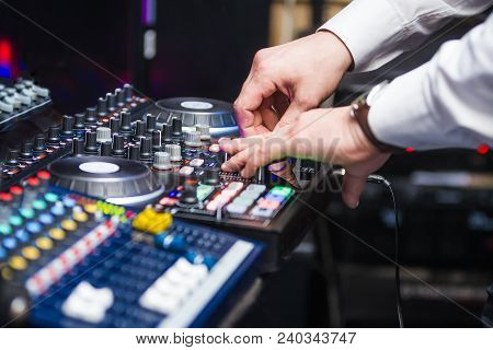 Closeup Hands Of Dj At The Turntable Wearing In White Shirt. Disc Jockey Playing On The Best, Famous