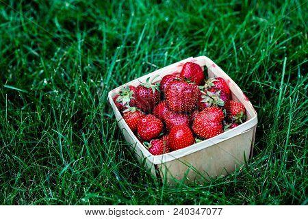 Strawberry inside wooden basket