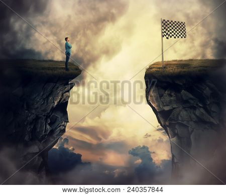 Business Problem As A Young Man Stand On A Cliff Need To Go The Other Side To Reach The Finish Flag.
