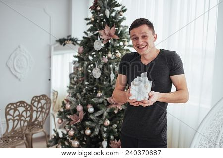 Male Holding A Gift Box And Smiling. Christmas Day Concept. Handsome Man In Shirt With A Present Gif