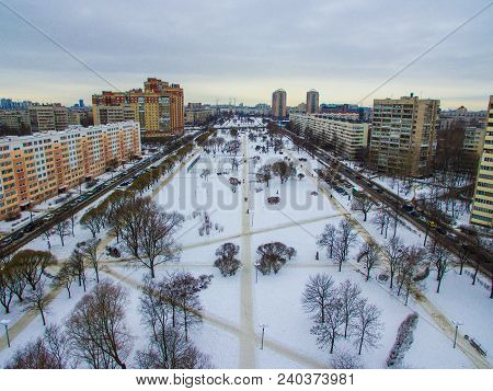 Drone View Of Park, Street And Apartment Buildings In Winter Day, Saint Petersburg, Russia