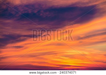 Beautiful Cloudscape At Scarlet Sunset With Colorful Contrasting Cirrus Clouds