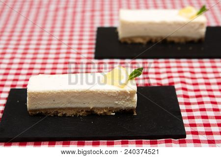 Lemon Cheesecake A Thin Slice Of A Homemade Lemon Cheesecake Made On A Biscuit Base