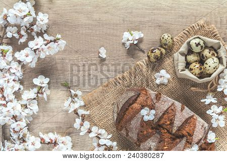 Apricot Tree Blossom Branch, Quail Eggs And Rye Bread On The Wooden Background With Copy Space, Tone