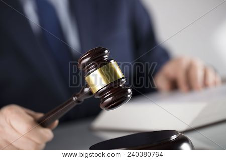 Law Concept. Judge, Gavel And Legal Code. White Background. Man In Suit.