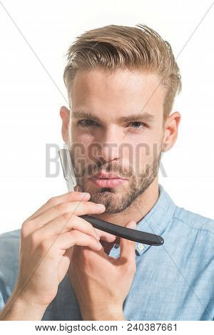 Barbershop Concept. Attractive Yound Barber With Beard And Mustache While Holding Straight Razor Nea