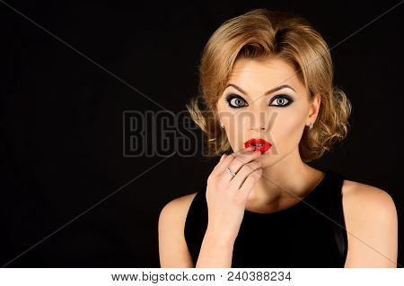 Interested Woman In Black Dress. Girl In Black Dress. Evening Make Up. Isolated On Black Background.