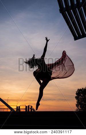 Elegant ballet dancer woman dancing ballet in Singapore city