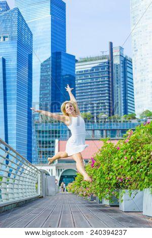 Elegant ballet dancer woman dancing ballet in the city of Singapore