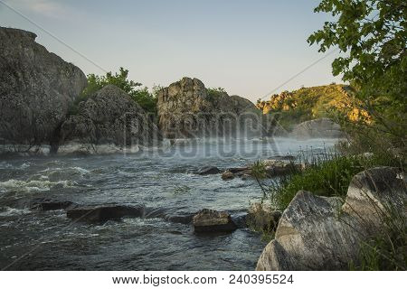 Small Mountain River. Landscape With Stream Flowing Between Rocks. Water In Mountains. River In Spri