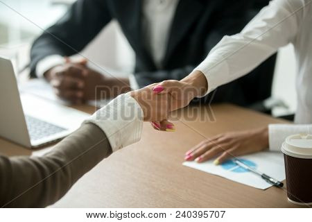 Black And White Female Hands Shaking At Group Meeting, Diverse Businesswomen Handshaking Greeting Or