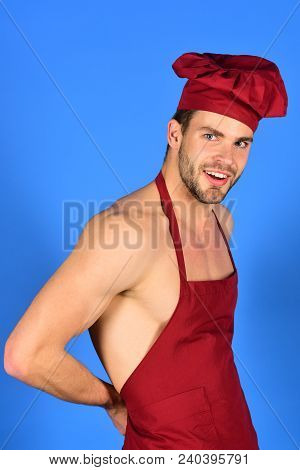 Chef In Burgundy Uniform. Man In Cook Hat, Apron. Cooking, Profession, People Concept - Restaurant E