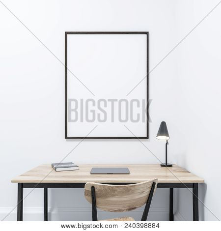 Minimalistic Home Office Or Study Interior With White Walls, And A Table With An Office Chair. A Fra