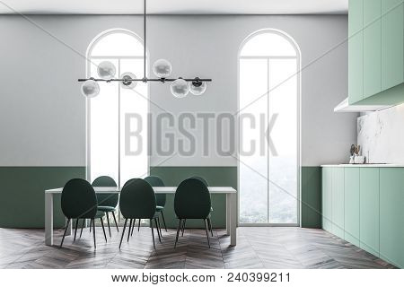 Green Wall Dining Room And Kitchen With Green Chairs Standing Around The Table. An Arched Window. Co