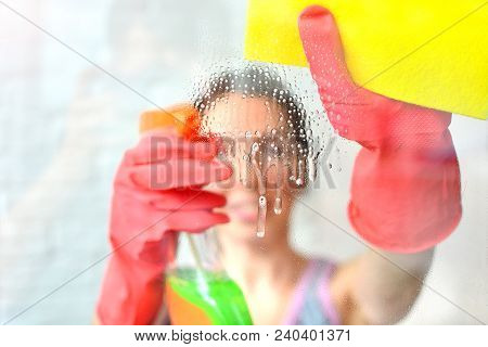 Window Cleaning. Woman From Cleaning Company Washes Windows With A Professional Equipment. Housewife
