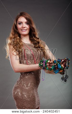 Pretty Young Woman Holding Hat And Many Plentiful Of Precious Jewelry Necklaces Beads. Gorgeous Fash
