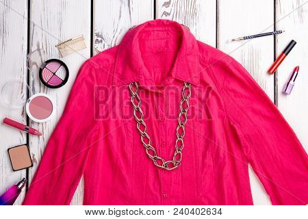 Female Clothes And Cosmetics Background. Flat Lay Women Fashion Shirt And Cosmetics Makeup Products.
