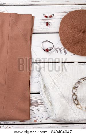 Set Of Ladies Autumn Fashion Outfit. Flat Lay Of Women Classic Garment On White Wooden Background. F