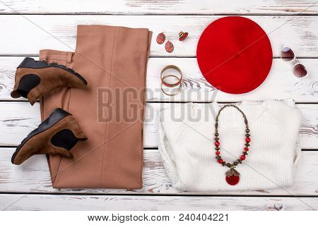 Composition From Female Clothes And Accessories. Flat Lay Woman Fashion Apparel And Red Color Jewelr