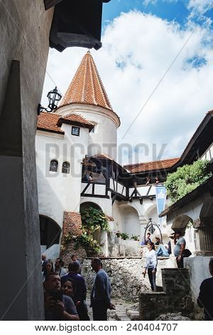 Bran, Romania - September 7, 2017: Tourists Visit The Courtyard Of Bran Or Dracula Castle And Make B