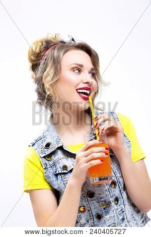 Happy Life Ideas And Concepts. Upbeat And Happy Caucasian Blond Girl Posing With Orange Juice And St