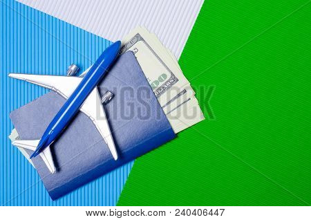 Miniature Airplane Passport Money Abroad On Colorful Blue White Green Background
