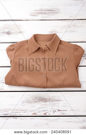 Female New Shirt, Wooden Background. Women Classic Blouse Folded On Wooden Table. Store Of Business