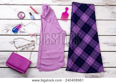 Female Purple Color Clothes And Accessories. Ladies Fashion Design Garment And Beauty Essentials On