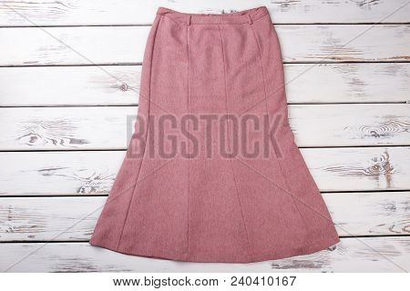 Classy Female Skirt, Wooden Background. Beautiful Women Skirt On Sale. Female Classic Outfit.