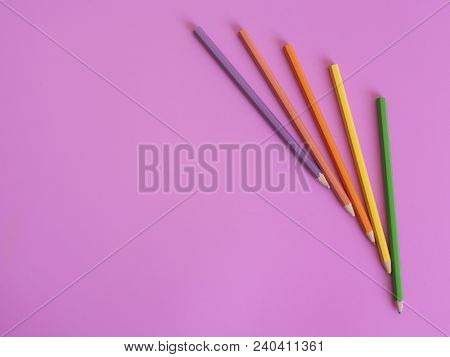 Colour Pencils Isolated On Pink Background