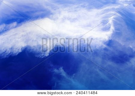 Cloud Formation, Background With Blue Sky And Cirrus Clouds. Cirrus Fibratus, Cirrus Clouds In Latin