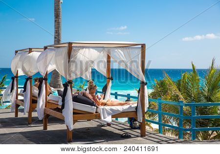 Mexico, Cancun - February 15, 2018: Sun Beds Facing To The Caribbean Sea In Grand Pyramid Hotel. Peo